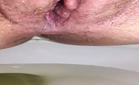 Shaved wife shitting in toilet