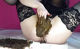 Brunette girl masturbating with poop
